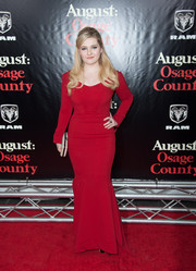 Abigail Breslin played up her voluptuous figure in a curve-hugging red mermaid gown by Zac Posen during the 'August: Osage County' NYC premiere.
