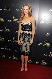 Nicole Kidman topped off her lacy cocktail dress with silver strappy sandals.