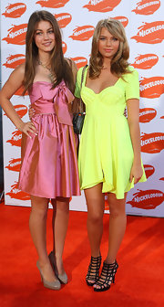 Indiana Evans was an attention-grabber in her super-feminine neon yellow mini dress at the 2009 Australian Nickelodeon Kids' Choice Awards.