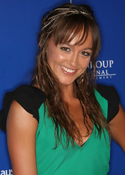 Sharni sported a multi-chain accessory with a tousled hairstyle.