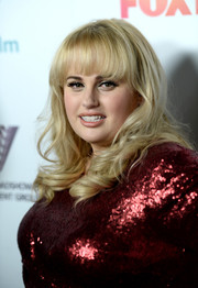 Rebel Wilson worked flirty curls with wispy bangs at the Australians in Film Awards.