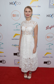 Lucy Fry chose a pair of black and-white peep-toe heels by Aquatalia to finish off her look.