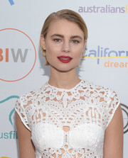 Lucy Fry wore her short hair slicked down with a side part at the Heath Ledger scholarship dinner.