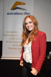 Isla Fisher looked smart in a raspberry tweed jacket at the screening of 'Keeping Up with the Joneses.'