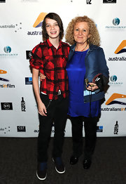 Kodi Smit-McPhee attended the Australians in Film Screening of 'Matching Jack' wearing an orange-and-black double-pocket plaid flannel shirt.