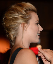 Margot Robbie opted for a classic French braid when she attended the 'Wolf of Wall Street' screening in LA.