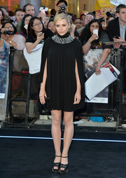 Elizabeth Olsen paired her dress with studded black platform sandals, also by Saint Laurent.