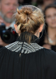 Elizabeth Olsen topped off her look with a messy-chic twisted bun when she attended the European premiere of 'The Avengers: Age of Ultron.'