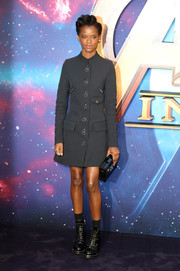 Letitia Wright was tough-chic in a military-inspired gray coat dress by Louis Vuitton at the 'Avengers: Infinity War' UK fan event.