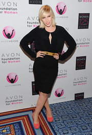 Natasha Bedingfield added a pop of color to her red carpet ensemble with coral platform pumps.