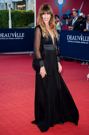 Lou Doillon went for gothic glamour at the 'Snowpierce' premiere in a flowy black Saint Laurent gown with sheer blouson sleeves and a plunging neckline.