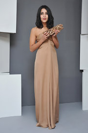 Leila Bekhti looked simply stunning in a nude strapless dress at the Cesar Film Awards.