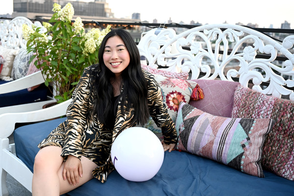 Awkwafina Short Suit [beauty,sitting,leisure,smile,furniture,black hair,awkwafina,rooftop,the williamsburg hotel,brooklyn,new york,hoteltonight party]