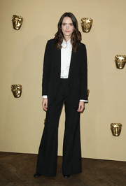 Stacy Martin went retro with this black bell-bottom pantsuit at the BAFTA Breakthrough Brits reception.