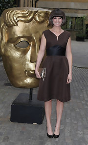 Dawn O'Porter chose this brown dress that featured a wide sash-like belt for her evening look at the BAFTA Craft Awards.