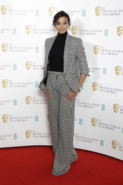 Ella Balinska attended the BAFTA Film Awards nominations announcement wearing a stylish houndstooth pantsuit.