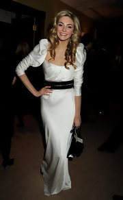 Tamsin Egerton wore a conservative satin gown fit for the BAFTAs.
