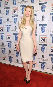 Talulah Riley showed off her sleek figure in a cream bandage dress while attending the BAFTA Awards.