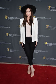 Dakota Johnson cut a strong silhouette in her white blazer at the BAFTA LA garden party.