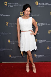 Tehmina Sunny looked very ladylike in a little white lace dress at the BAFTA LA garden party.