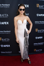 Kate Beckinsale donned an Ulyana Sergeenko strapless gown with a deep sweetheart neckline and lace detailing for the BAFTA LA garden party.