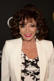Joan Collins attended the BAFTA LA TV Tea looking as gorgeous as ever with her high-volume curls.