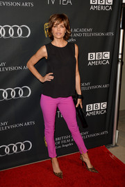 Lisa Rinna opted for a casual red carpet look with this sleeveless black blouse and purple skinnies combo at the BAFTA LA TV Tea.