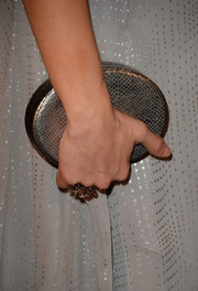 Allison Holker accessorized with a chic silver oval clutch at the BAFTA LA TV Tea.