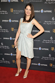 Alison Brie worked it in a modern gray cocktail dress with a gathered waist and an asymmetrical hemline at the BAFTA Los Angeles tea party.