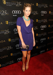 Claire Holt looked pretty in purple at the BAFTA LA Tea party.