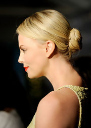 Charlize Theron wore her hair in a sleek bun at the 18th Annual BAFTA Awards Season Tea Party.