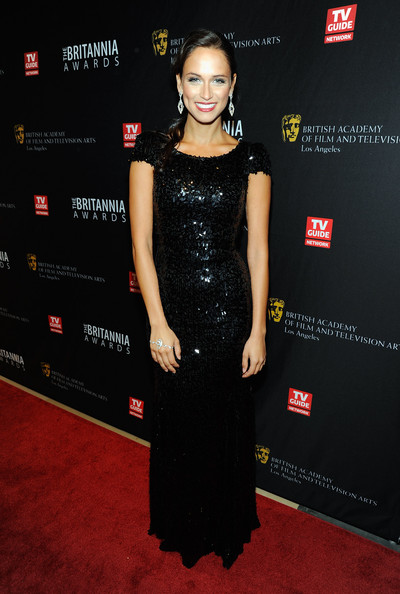 Asha Leo dazzled in a black beaded floor-length gown with cap-sleeves for the BAFTA Britannia Awards.