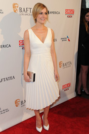 Joanne Froggatt was elegant in a V-neck white ruffled gown with cut-out details on the back that she matched with a box clutch and pointed heels.
