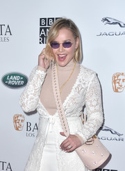 Abbie Cornish attended the BAFTA Los Angeles + BBC America TV Tea Party carrying an embroidered nude bucket bag.