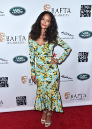 Silver glitter sandals with double ankle straps finished off Thandie Newton's look.