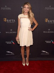 Sarah Hyland kept it youthful yet sophisticated at the BAFTA Los Angeles tea party in a Bibhu Mohapatra cocktail dress with a sheer-panel yoke and a pleated skirt.