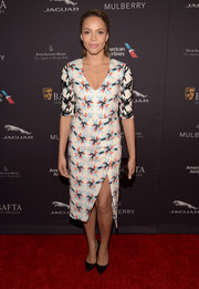 Carmen Ejogo looked chipper at the BAFTA Los Angeles tea party in a Tanya Taylor print dress with a plunging neckline and a thigh-baring slit.