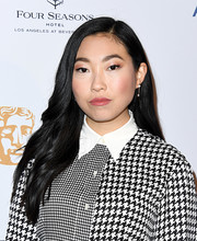 Awkwafina accessorized with a pair of pearl drop earrings.