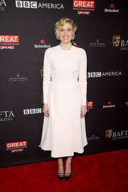 Greta Gerwig styled her LWD with a pair of black cutout pumps.