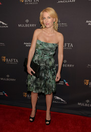 Gillian Anderson looked mildly edgy in an abstract-print strapless dress during the BAFTA Los Angeles tea party.