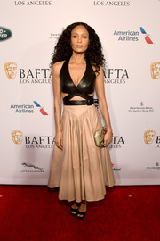 Simple black platforms completed Thandie Newton's outfit.