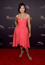 Karen David polished off her look with a pair of bedazzled strappy sandals.