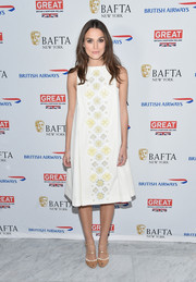 Keira Knightley complemented her charming frock with stylish tan peep-toes with white trim and strappy accents.