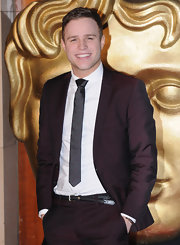 Olly Murs was faraway from his usual geeky look at the BAFTA's as he wore a suit with a satin tie to match it.