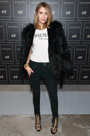 Elena Perminova matched her jacket with a pair of green suede skinnies, also by Balmain x H&M.