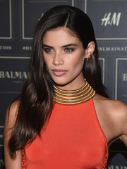Sara Sampaio wore a side-parted 'do with subtle waves to the Balmain x H&M collection launch.