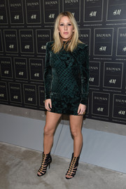 Ellie Goulding styled her dress with fierce black gladiator heels, also by Balmain x H&M.