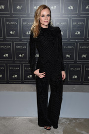 Diane Kruger cut a strong silhouette in this long-sleeve black velvet-burnout top by Balmain x H&M during the collaboration's launch.