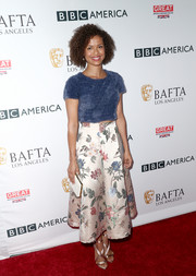Gugu Mbatha-Raw completed her outfit with mauve cross-strap sandals.