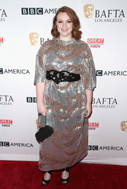 Shannon Purser polished off her ensemble with a beaded black purse by Ingie Paris.